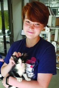 teen volunteer with kitten
