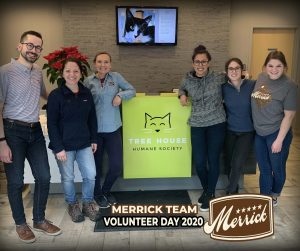 merrick team standing by tree house front desk